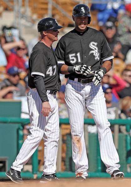 Alex Rios and third base coach Joe McEwing confer against the Los Angeles Dodgers on Sunday.