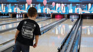 Dozens of people knocked down pins Sunday to build up women as Sunshine Lanes sought to raise money for Susan G. Komen for the Cure.