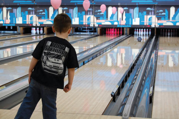 Rylan Nichols, 3, of Waynesboro, Pa., checks out the trajectory of his bowling ball Sunday at Sunshine Lanes in Rouzerville, Pa. The bowling alley hosted a fundraiser for Susan G. Komen for the Cure.