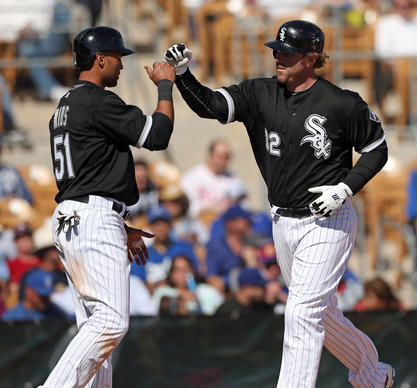Alex Rios greets Adam Dunn after  Dunn hit a 2-run home run in the fourth inning.