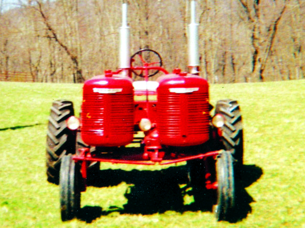"""Cramer built a custom Farmall """"Double A"""" in 2005. The project started out with two 1944 Farmall A parts tractors that he planned to combine to make one nice tractor. While all of the parts were laying around the garage, he found a way to bolt the rear ends together and decided to build a unique double tractor instead."""
