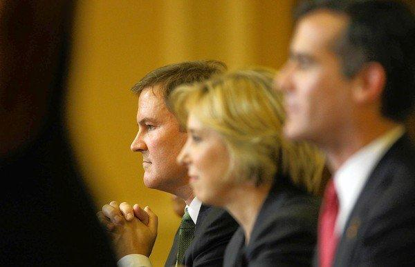 Los Angeles mayoral candidates, from left, Kevin James, Wendy Greuel and Eric Garcetti listen to a question during a debate in Hollywood. Before becoming a radio talk show host, James was an entertainment lawyer.