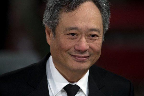 Director Ang Lee poses on the red carpet upon arrival to attend the annual BAFTA British Academy Film Awards at the Royal Opera House in London.