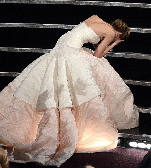 "As if we didn't already find Jennifer Lawrence endearing enough, she tripped on her way to the stage to accept her Best Actress award for ""Silver Linings Playbook."" Never has a tumble been so charming! (We even think it's adorable that she forgot to thank her director, David O. Russell. Because she's just... so Jennifer Lawrence.) <br><br> <i>-- <a href=""http://twitter.com/cadlymack"">Carina Adly MacKenzie</a>, <a href=""http://www.zap2it.com"">Zap2it</a></i>"
