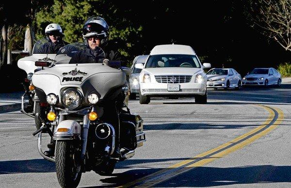 A procession carrying the bodies of Keith Lawrence and Monica Quan, a couple killed by former LAPD Officer Christopher Dorner on Feb. 3, leaves Concordia University after a memorial service Sunday.