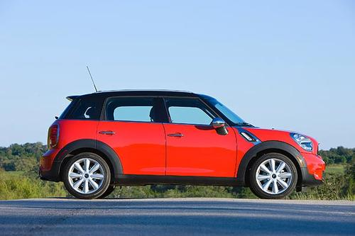 The Countryman is 15 inches longer than the Cooper hardtop -- the better to accommodate doors, back-passenger legs and groceries. It's a car that finds the middle ground between fun and practicality. <br>