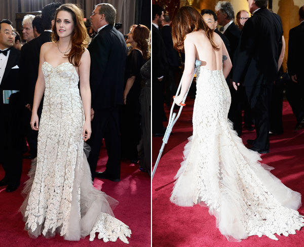 Kristen Stewart looks truly uncomfortable in this frothy Reem Acra dress. And what's with her bed-head hair?