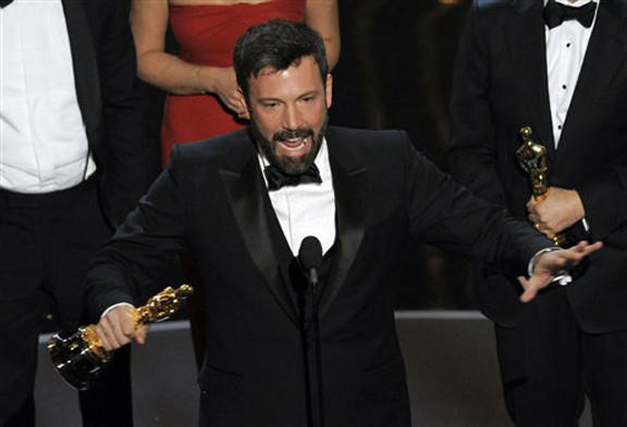 "Director/producer Ben Affleck accepts the award for best picture for ""Argo"" during the Oscars at the Dolby Theatre on Sunday in Los Angeles."
