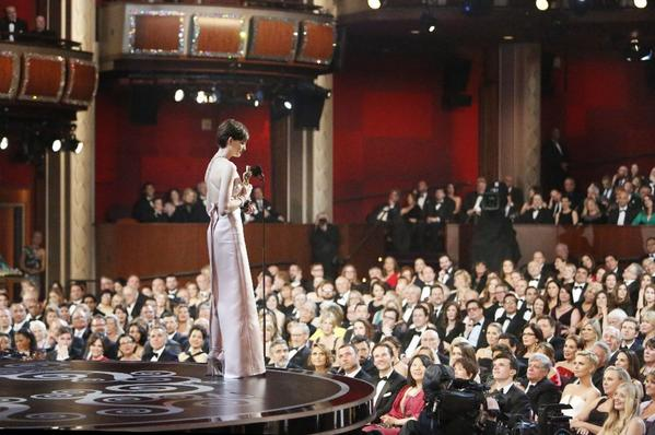 "Anne Hathaway holds her Oscar for supporting actress in ""Les Miserables"" on Sunday at the Dolby Theatre."
