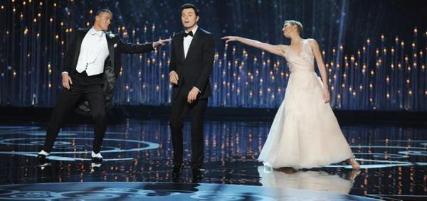 Channing Tatum and Charlize Theron dance to a song sung by Oscars host Seth MacFarlane.