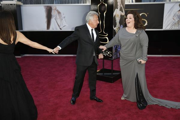 Strange David Lynchian moment on the red carpet: While Dustin Hoffman was talking to E! red carpet host Ryan Seacrest in the little secondary window in the corner of the TV screen during E's broadcast, Melissa McCarthy was shown posing for photographers in the larger picture. Suddenly, Hoffman appeared in the larger window to greet McCarthy at the same time he was talking to Seacrest. It's still unclear if one was time-delayed video or Hoffman has a doppelganger at the Oscars.