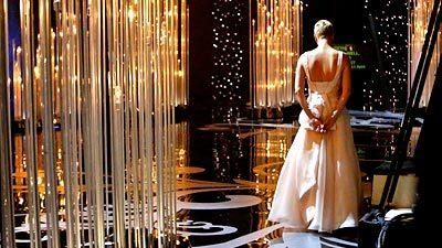 Actress and presenter Charlize Theron backstage at the 85th Academy Awards.