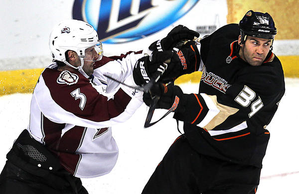 Colorado's Ryan O'Byrne checks Anaheim's Daniel Winnik at Honda Center in Anaheim on Sunday.