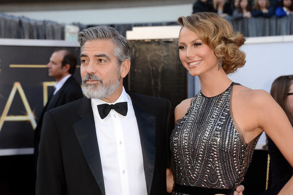 Stacy Keibler and George Clooney arrive at the 2013 Oscars. Keibler wore a beaded Naeem Khan gown and, according to Us Weekly, Giuseppe Zanotti shoes, Lorraine Schwartz jewels and a Tiffany & Co bag.