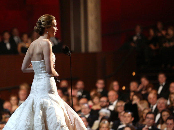 "Jennifer Lawrence accepts the award for best actress in a leading role for ""Silver Linings Playbook"" during the Oscars."
