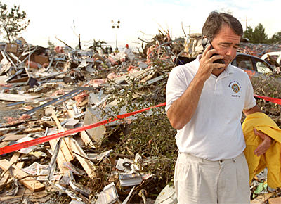 No rescue for office: Steven Edwards, director of the Maryland Fire and Rescue Institute, makes a call amid the wreckage of the institute on the University of Maryland, College Park campus.