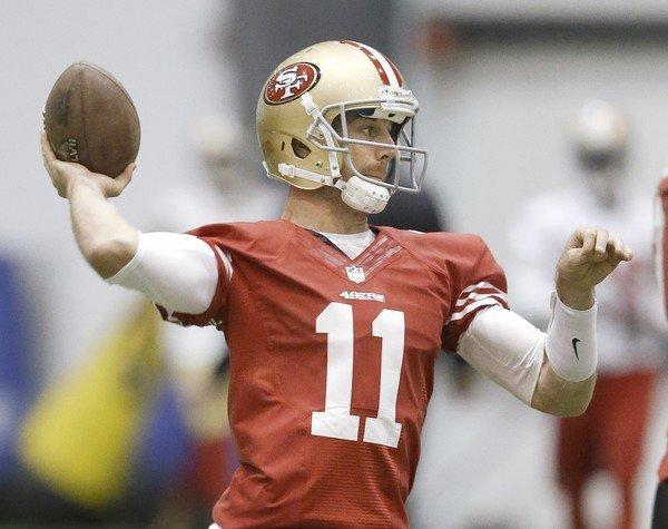 San Francisco quarterback Alex Smith passes during a practice in New Orleans before the Super Bowl.