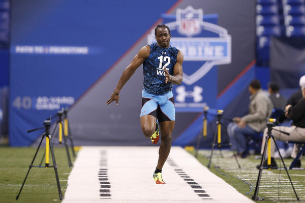Cobi Hamilton of Arkansas runs the 40-yard dash during the 2013 NFL combine at Lucas Oil Stadium  in Indianapolis on Sunday.
