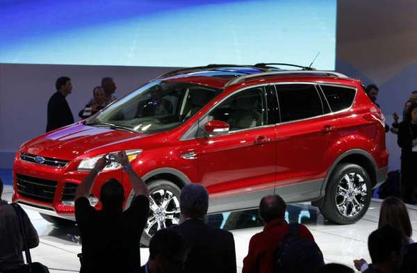 A Ford Escape is shown at the Los Angeles Auto Show in 2011. It's one of the models being investigated for possible stalling problems.