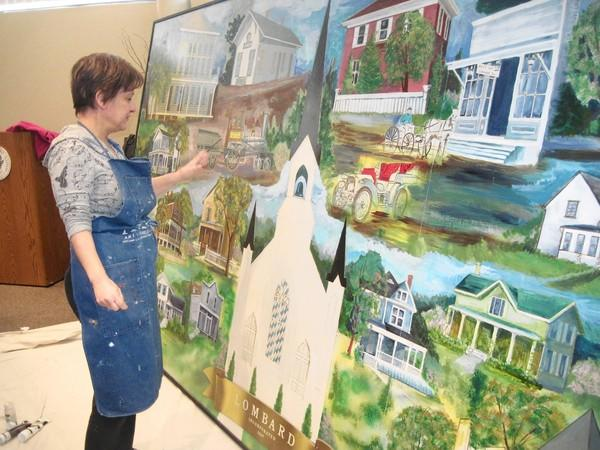 Lombard trustee Laura Fitzpatrick works on a mural that will hang over a renovated reception area in the Lombard Village Hall.