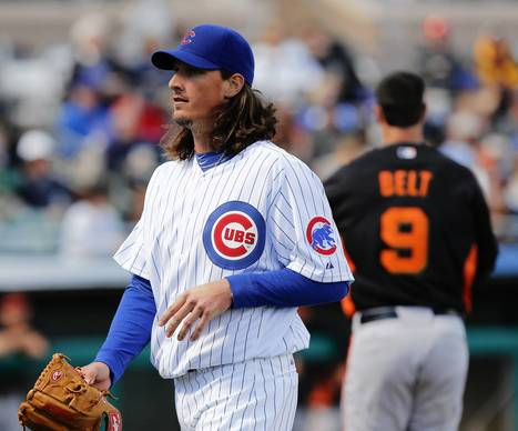Cubs starting pitcher Jeff Samardzija (29) walks to the dugout after finishing the first inning against the San Francisco Giants in a Cactus League game at HoHoKam Park in Mesa, Ariz. on Sunday.
