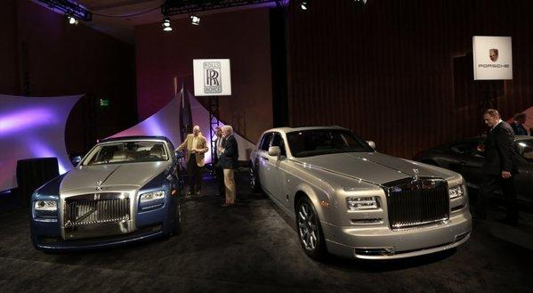 Attendees view two Phantom luxury automobiles, produced by Rolls-Royce Motor Cars Ltd., at the MGM Grand Detroit. Rolls-Royce is recalling some of the cars because of a problem that could increase the risk of a fire.