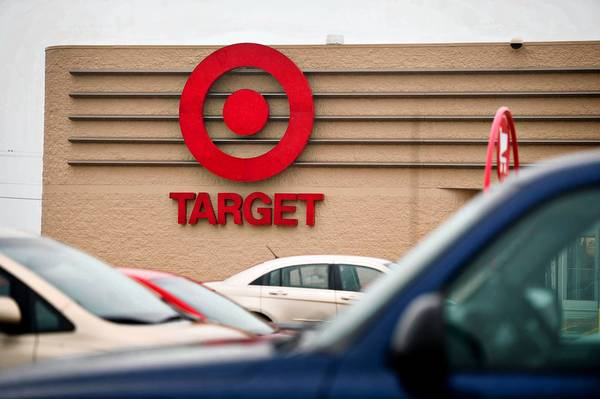 Car sit parked in front of a Target in Peru, Il. Lake Bluff officials said traffic was one of their biggest concerns about a proposal to build a Target in the North Shore suburb.