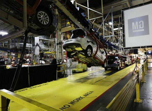Cars move along an assembly line at the General Motors Fairfax plant in Kansas City, Kan.