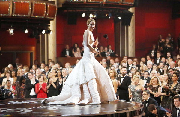 Jennifer Lawrence is congratulated after winning the lead actress Oscar.