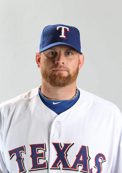 Texas Rangers pitcher Kyle McClellan poses for a portrait during photo day at Surprise Stadium.