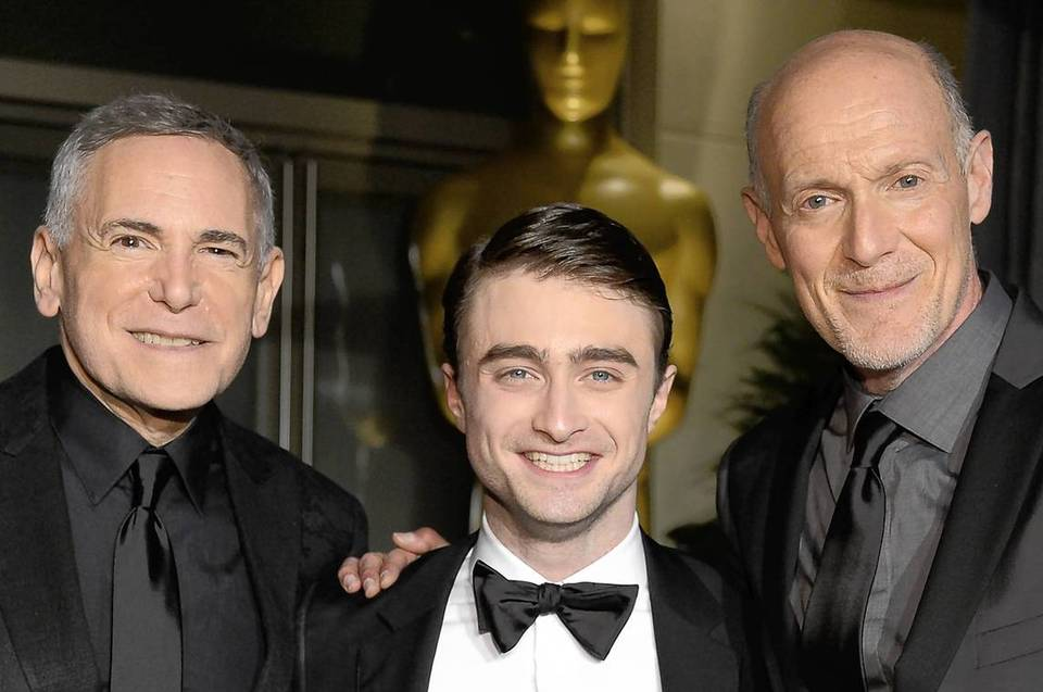 Producer Craig Zadan, actor Daniel Radcliffe, and producer Neil Meron attend the Oscars Governors Ball.