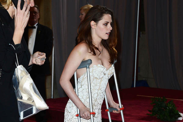 Kristen Stewart departs from the Oscars on crutches Sunday night in Hollywood.
