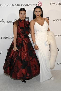 Television personality Kim Kardashian, right, and television personality Kourtney Kardashian.