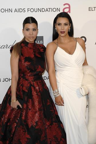 Television personality Kim Kardashian, right, and television personality Kourtney Kardashian.