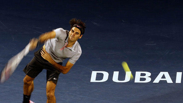 Switzerland's Roger Federer serves the ball to Tunisian Malek Jaziri during the tennis match of the ATP Dubai Open in the Gulf emirate on February 25, 2013.