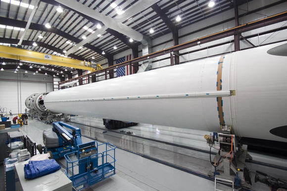 CAPE CANAVERAL, Fla. ¿ Inside the SpaceX Falcon Hangar at Launch Complex 40 on Cape Canaveral Air Force Station in Florida, the first stage of the Falcon 9 rocket is placed in a workstand for prelaunch processing.