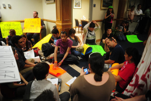 FAU protesters hold a sit-in in the office of President Mary Jane Saunders on the campus in Boca Raton.
