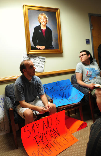 FAU protesters sit in the office of President Mary Jane Saunders. The students were protesting the school's decision to accept money from a private prison company to put its name on the football stadium.