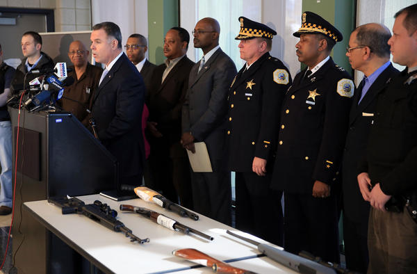 Chicago Police Superintendent Garry McCarthy, along with fellow police, neighborhood supporters and elected officials discuss and display recently seized  guns at the Chicago Police Englewood (7th ) District on Monday. Chicago Police say have recovered more than 1,080 weapons off the streets so far in 2013.