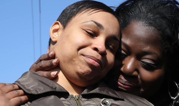 Nicole Harris leaves Dwight Correctional facility today and is embraced by her cousins, Wanda, right, and Lawanda Harris. Harris, who has been locked up since the 2005 death of her son, walked out of prison today after an appeals court threw out her murder conviction.