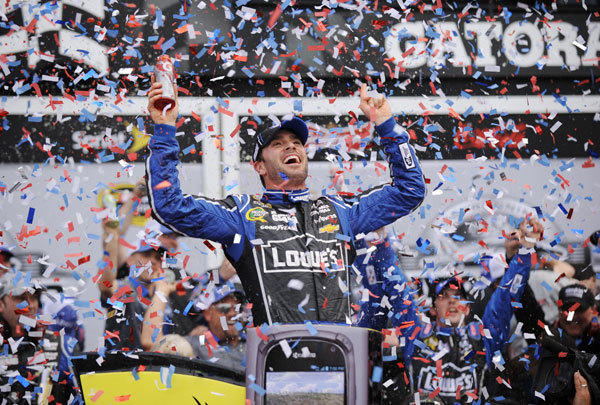 NASCAR Sprint Cup Series driver Jimmie Johnson celebrates in victory lane after winning the 2013 Daytona 500 at Daytona International Speedway.