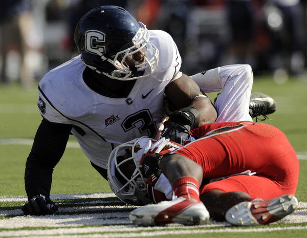 Sio Moore makes the sack on Teddy Bridgewater of Louisville at Papa John's Stadium in Louisville Saturday afternoon but was called for a personal foul.