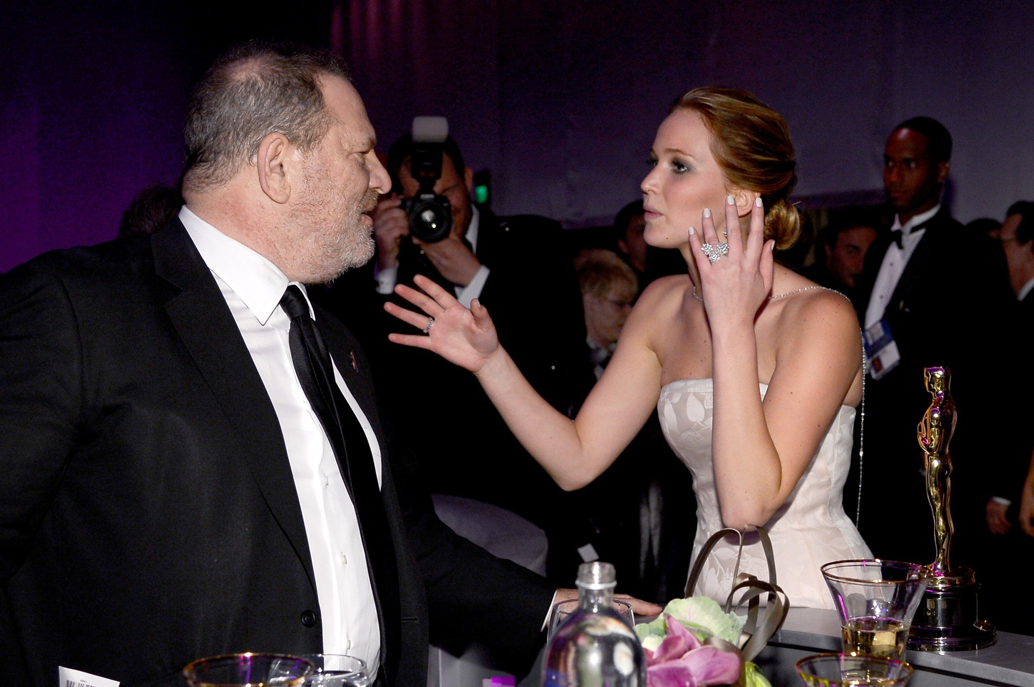 """Silver Linings Playbook"" producer Harvey Weinstein talks with Oscar winner Jennifer Lawrence at the 2013 Oscars Governors Ball. (Kevork Djansezian / Getty Images)"