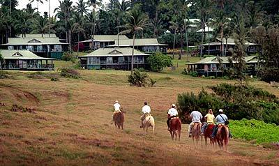 A trail ride lets guests play paniolo, or cowboy, near the cottages at the remodeled Hotel Hana-Maui.