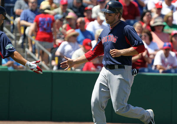 Boston Red Sox first baseman Lars Anderson (62) scores a run in the fifth inning against the Philadelphia Phillies at Bright House Networks Field.