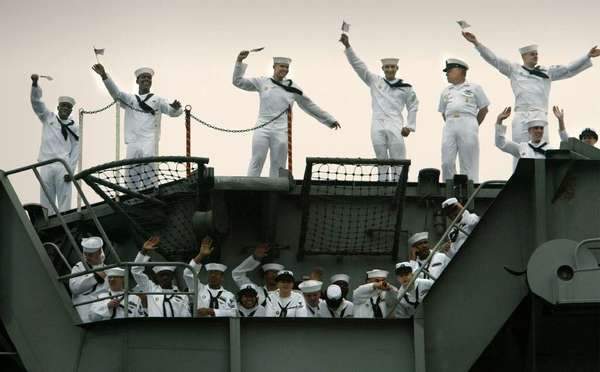 Sailors of the aircraft carrier Harry S. Truman wave on their return to Norfolk, Va., in 2003. The Truman battle was scheduled to return to the Persian Gulf this month but stayed home because of the federal budget sequester.