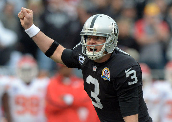 Oakland Raiders quarterback Carson Palmer (3) gestures against the Kansas City Chiefs at the O.co Coliseum.