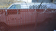 A Berger Cookie van sits behind a locked fence at the bakery's Cherry Hill facility