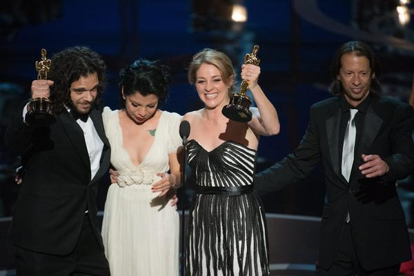 "Filmmakers Sean Fine, left, and Andrea Nix Fine, right, accept the Oscar for documentary short subject for ""Inocente,"" about teenage artist Inocente Izucar, center, during the 85th Academy Awards. The filmmakers raised money on Kickstarter."