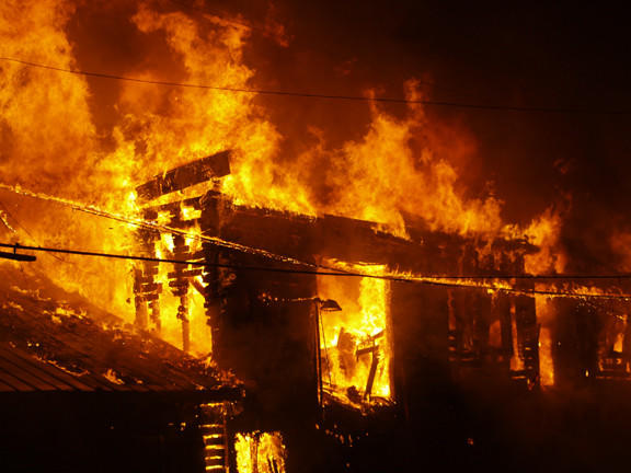 Flames shoot through the roof during a Monday morning fire that destroyed the Reel Deal Bait & Tackle shop at 26 Canal St. in Hancock.